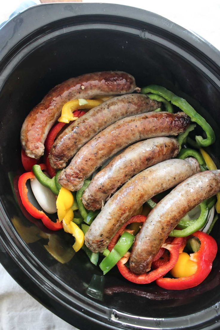 These Slow Cooker Sausages with Peppers and Onions is a no fuss meal with TONS of flavor! Serve with your favorite marinara to make it complete!