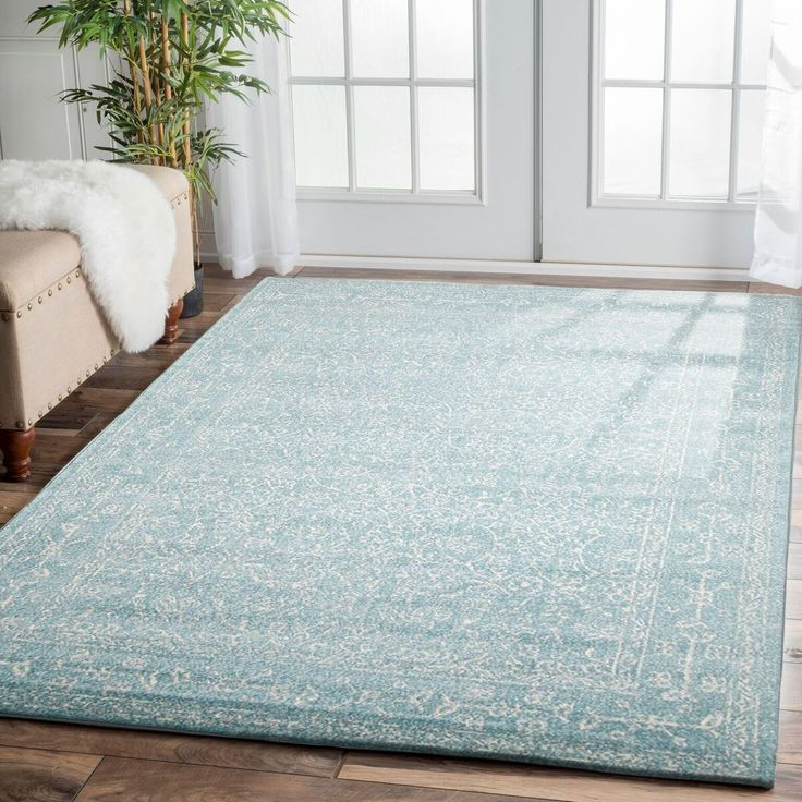 Add luxury and style to your floors with the Arcadia Blue Beige Patterned Transitional Designer Rug