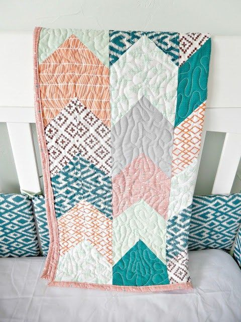 Arrow tail crib quilt for a baby boy nursery- check out the full room reveal by Kemley Design