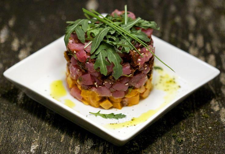 Tuna tartar with sweet potato, sun dried tomatoes, toasted sesame seeds, orange infused olive oil and arugula - Raspberry Flavor
