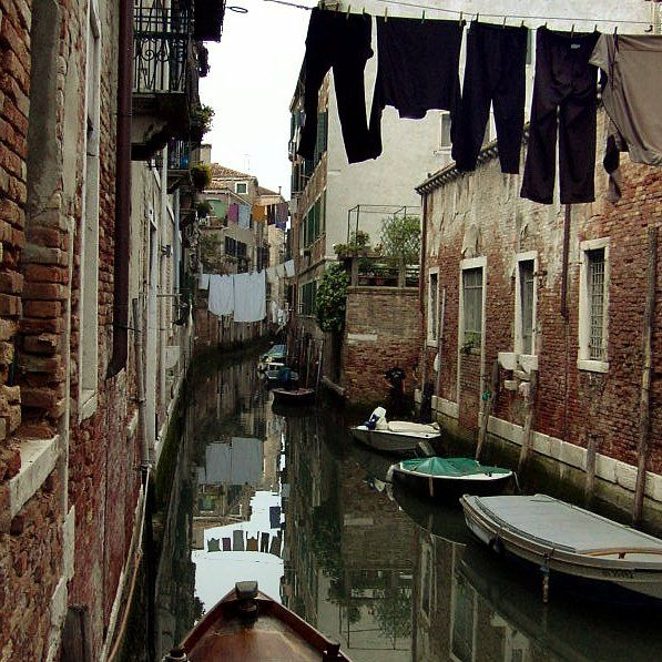 Quiet back canal in Venice, Italy.. love this - i would love to live in a tiny little home right there.