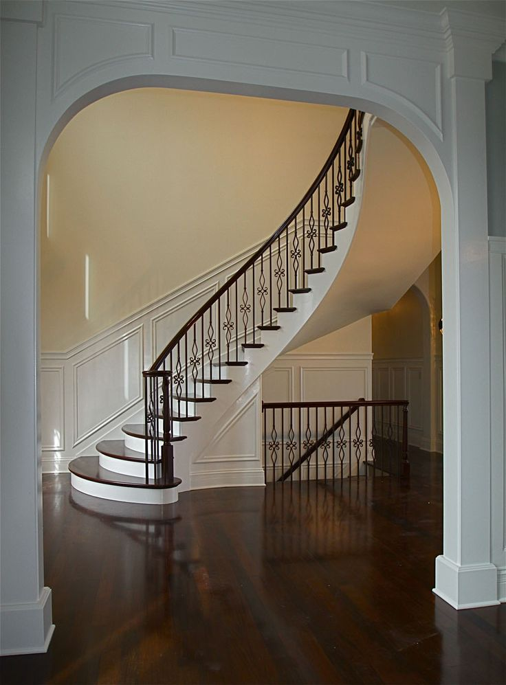 Wood and Wrought Iron Staircases | Stair: Delightful Home Interior Decoration With Curved Staircase Along ...