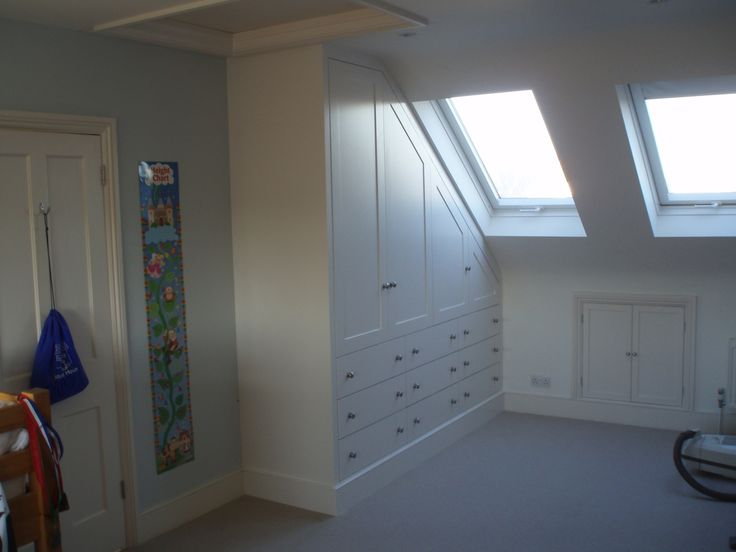 Under eaves storage eaves cupboard pinterest built for Eaves bedroom ideas