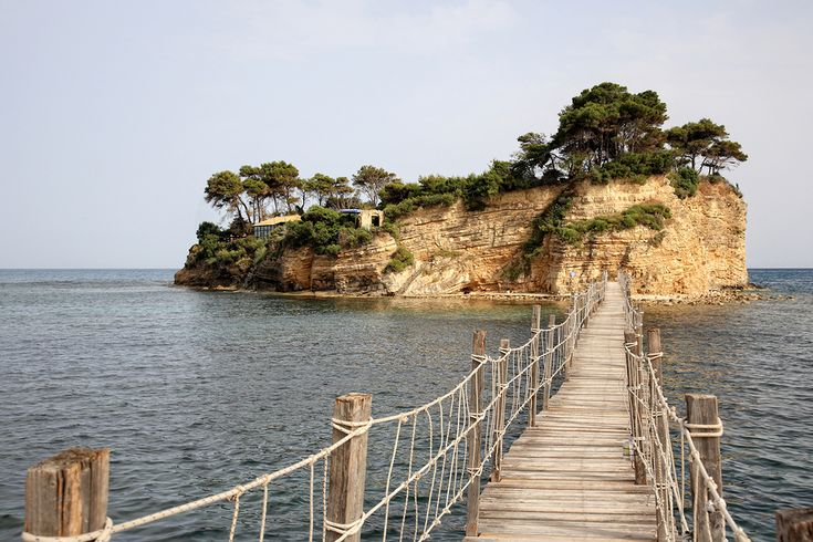 A small island with wooden bridge that cross the sea.. #Zakynthos