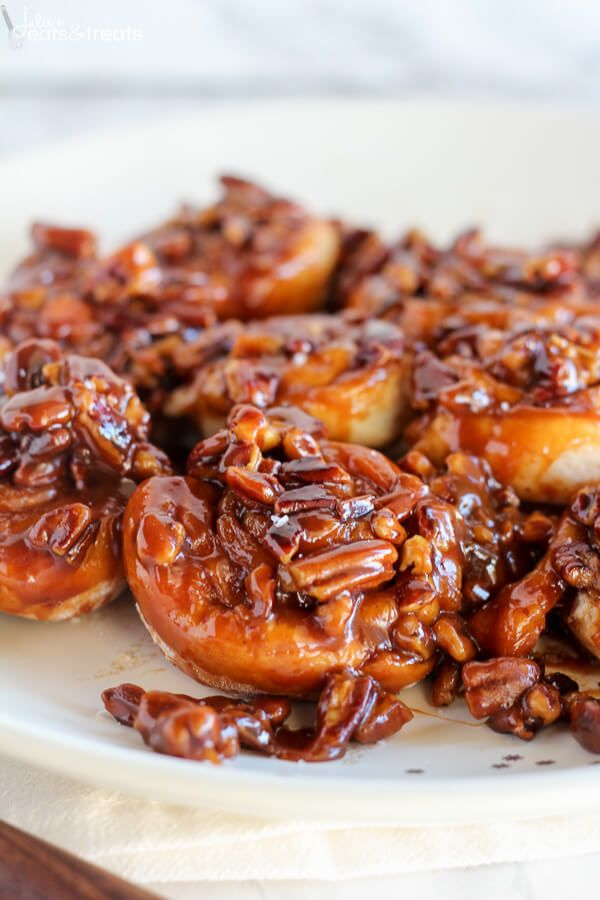 Easy 30 Minute Caramel Pecan Sticky Buns ~ Tender and gooey melt-in-your-mouth sticky buns topped with caramel sauce and chopped pecans. This easy recipe uses canned crescent roll dough and prepared caramel sauce! ~ http://www.julieseatsandtreats.com