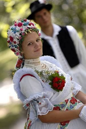 Europe | Portrait of a woman wearing traditional clothes, Palóc, Hungary Bujak ?