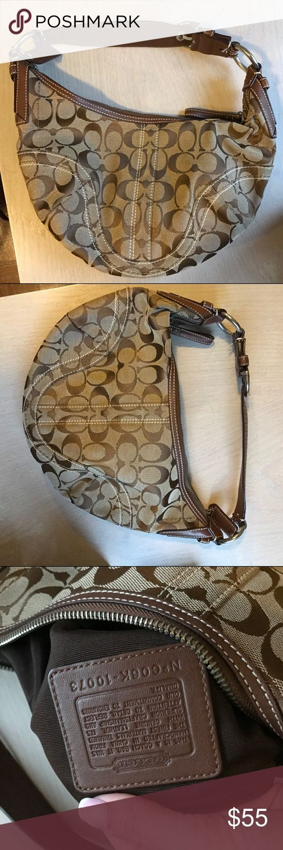 Small authentic monogram tan Coach hobo Perfect condition! Has small D keychain attached that can be removed but I will include it. 🌼Thank you for looking!  🌼I ship within 2 days shipping excluding holidays 🌼I do not trade! 🌼I only accept offers through the offer button! 🌼Thank you for shopping and feel free to ask any questions Coach Bags Hobos