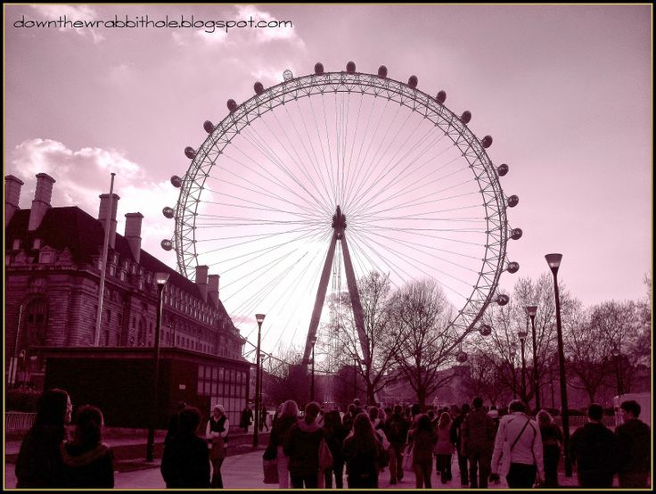 """Ride the gigantic London Eye in London. Find out more at """"Down the Wrabbit Hole - The Travel Bucket List"""". Click the image for the blog post."""