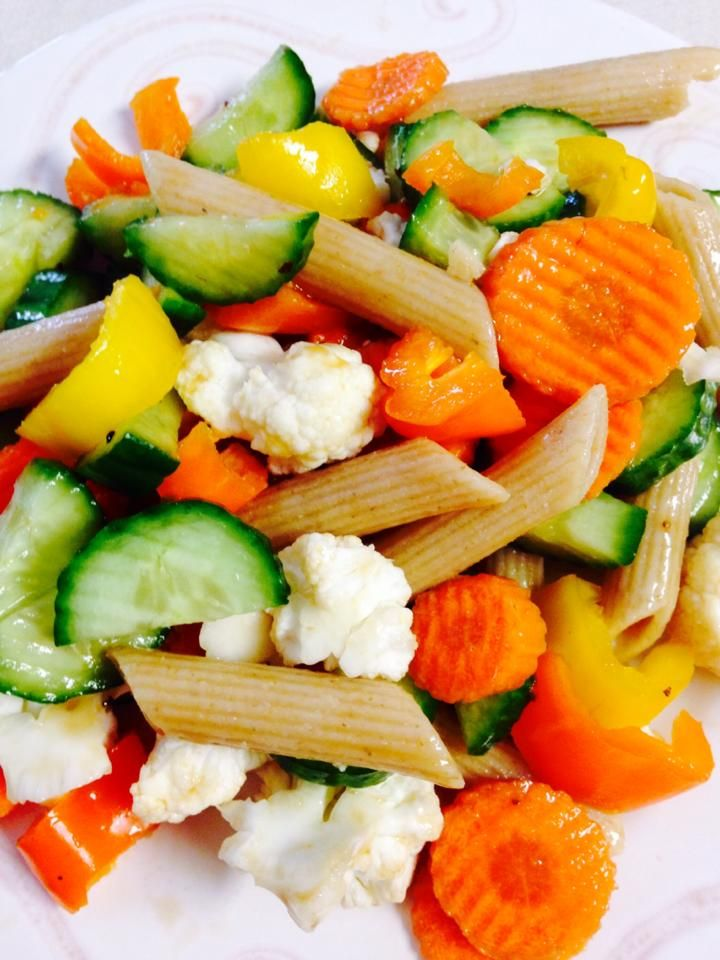Here's an easy way to healthy up your pasta salad...Make it about a 5:1 ratio of veggies to pasta. I cut up a bunch of veggies (this is carrots, sweet bell peppers, cauliflower, cucumber), add a handful of whole wheat pasta and mix in with your favorite dressing. Chill and wa-la!