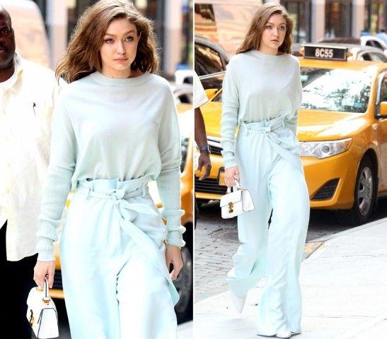 Gigi Hadid  DOVE: New York  LOOK: Chic. Il colore è quello dello zucchero filato. La modella indossa pantaloni palazzo morbidi legati in vita e maglia della stessa nuance leggera a maniche lunghe, tutto firmato Stuart Weitzman.