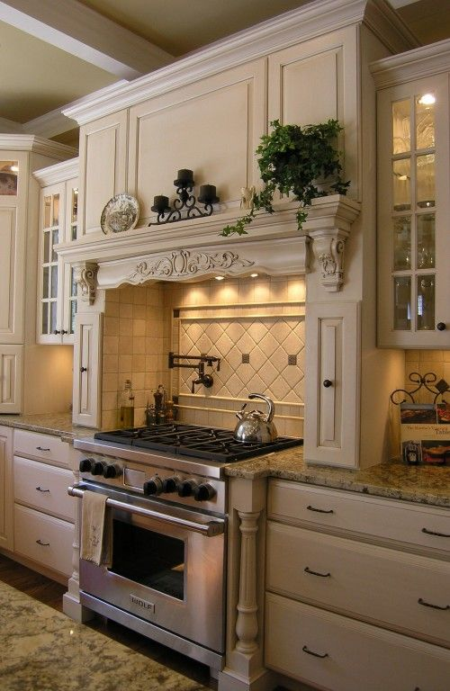 love this...   hood, spice cabinets on side, counter space on both sides with glass cabinets above