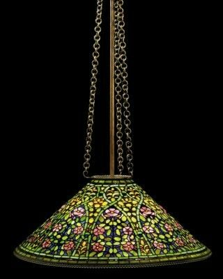 A TIFFANY STUDIOS LEADED GLASS AND PATINATED BRONZE CONICAL CEILING LAMP CIRCA 1910.