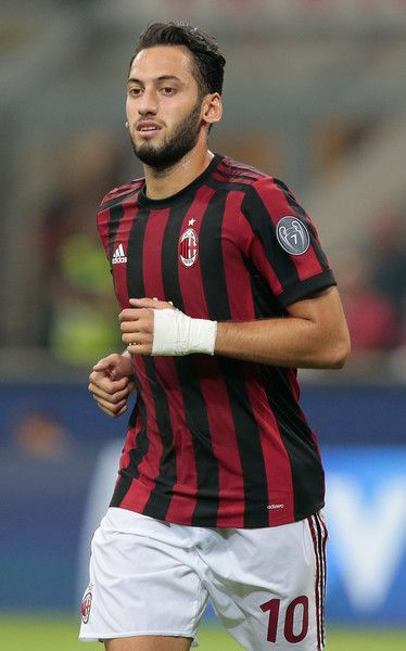 Hakan Calhanoglu of AC Milan looks on during the UEFA Europa League Third Qualifying Round Second Leg match between AC Milan and CSU Craiova at Stadio Giuseppe Meazza on August 3, 2017 in Milan, Italy.