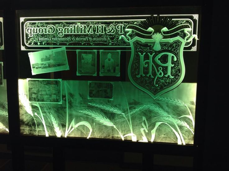 Glasswork Wildwood Signs lue chipping, glass carving gold gilding and glass photos  519-364-1503 Canada