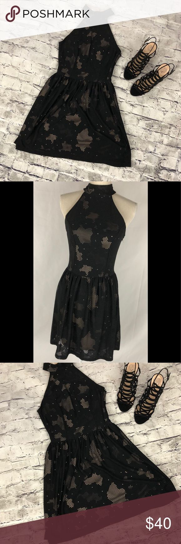 Women's small baby doll black dress! Women's small baby doll mystic black dress.  Two toned lace  Mock neck  For and flair  Baby doll Mystic Dresses Mini