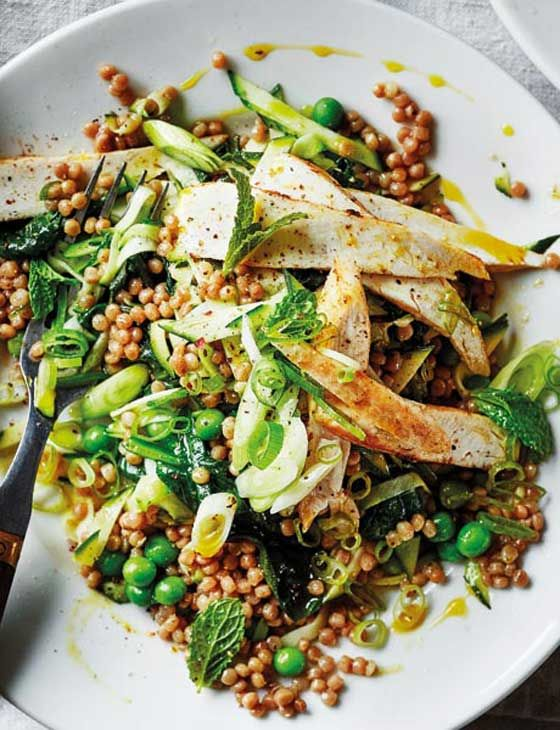Cumin chicken with giant couscous, courgette, peas and mint. A tasty and easy light spring lunch or dinner, ready in just 20 minutes.