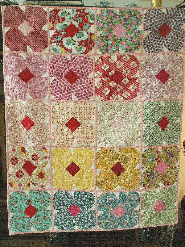 14 do.Good Comfort Circle April top finished. This quilt is made by 10 women not just me :-)