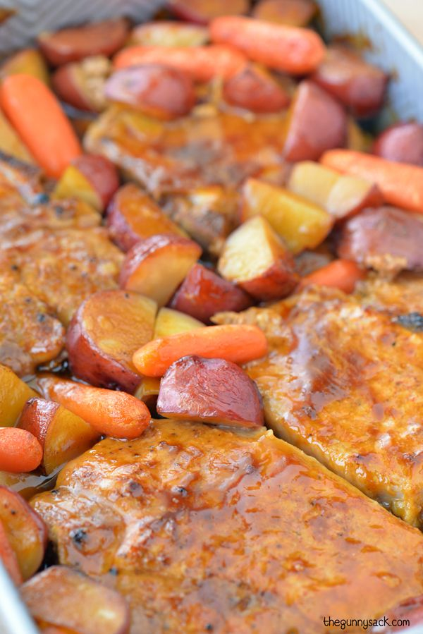 This easy recipe for Oven Roasted Pork Chops with potatoes and carrots is a delicious family dinner. Put everything in the oven and it bakes in 45 minutes.