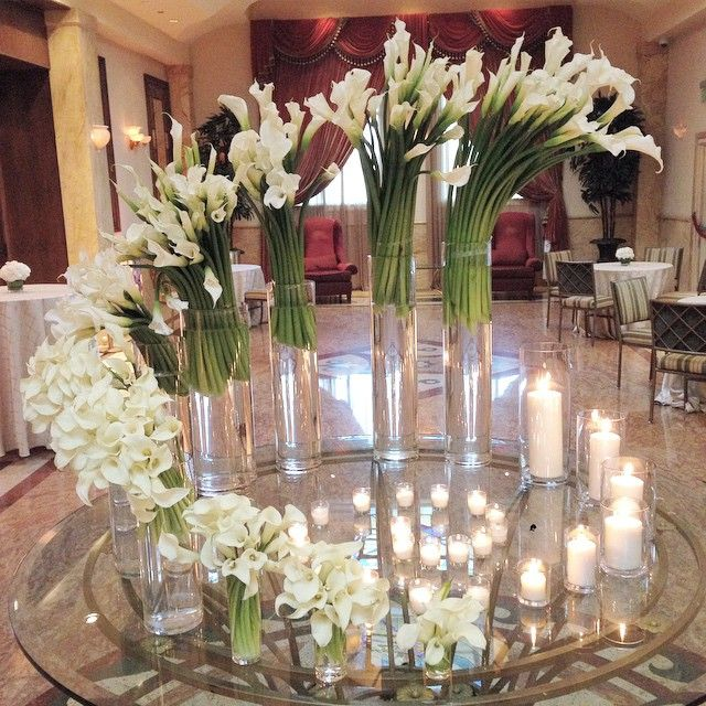 Foyer Floral installation by MOSAIC @taglyancomplex for this week's special wedding. #mosaicfloraldesign #floraldesign #eventdesign #floralinstallation #statement #contemporary #callalilies #candlelight #wedding #flowers #foyerflowers #pattern #copyright2015MOSAICfloraldesign