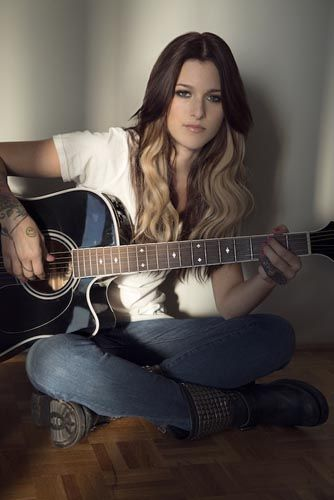 Cassadee Pope - I think this image is inspiration because of how simply the image is put together and how the light is shining of her as to say she is heavan.