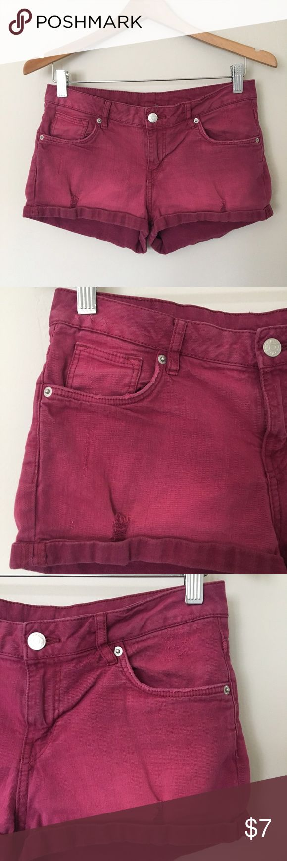 Distressed Deep Berry Shorts Distressed washed deep berry magenta denim shorts by Divided from H&M. Worn about 4-5 times and are still in very good condition. No flaws. Distressed markings and dye all throughout. I would say these are low-rise to normal fit. Disclaimer: first modeled photo is not mine; I found it online. However, the second modeled photo is mine. Tag says size 6. Please see measurements for better fit.  Measurements laying flat: Waist: 15 inches Length: 9.5 inches Inseam…