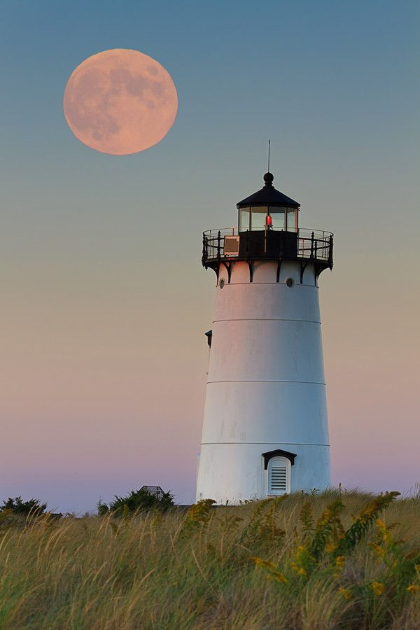 The full moon rising over the Edgartown Harbor Light on Martha's Vineyard. by Katherine Gendreau