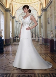 I have tried this one on, it is very flattering and it covers the tattoo on my back which my mom will like....possibilities  DaVinci Wedding Dresses - Style 8373