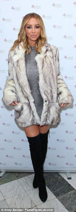 Winter style:Lauren Pope chose to keep covered up in her cosy faux fur coat, which she la...