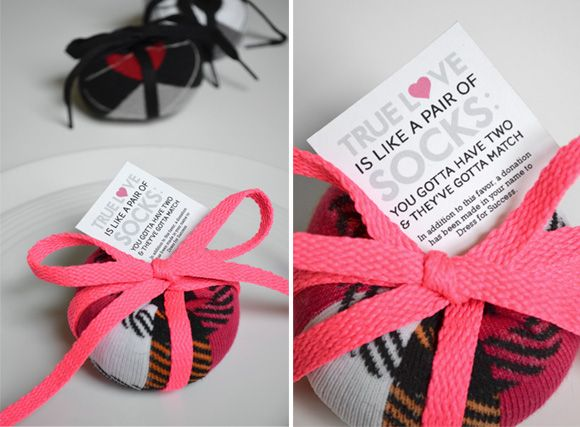 I bet you thought giving socks as wedding favors could never be so freakin' cute! DIY sock ball charity wedding favors, to be accompanied by a donation to Dress for Success