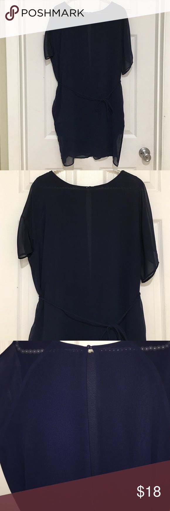 Sheer navy mini dress This cute, modern mini dress is made of sheer fabric, with lining along inside of dress body. The back has a sexy keyhole opening that stretches from the button closure at the neck to the tie waist. Dress also has pockets! EUC. Fabric content is 100% polyester. Make me an offer! Olivaceous Dresses Mini