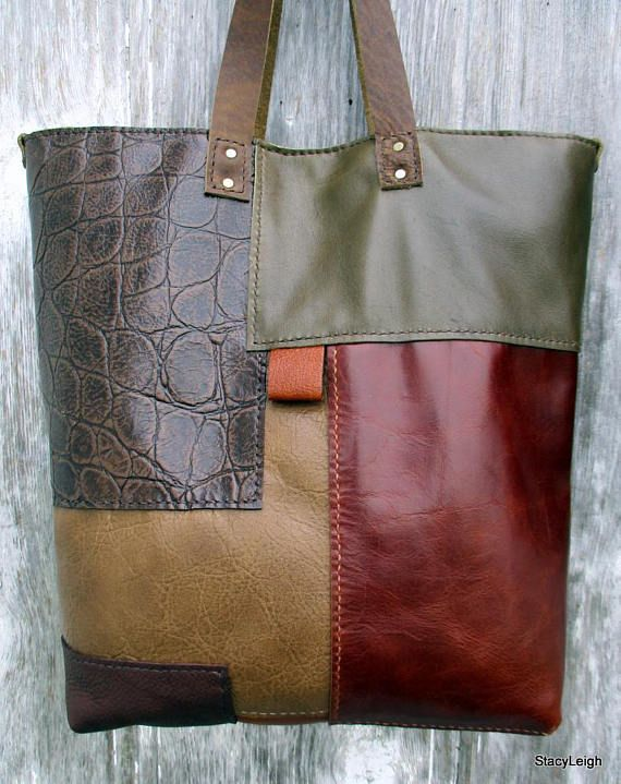 One of a kind, handmade, leather tote bag made with hand-sewn leather patches. The bag is primarily in a variety of brown leathers with some embossed, and one hair on patch. A bit of brown leather fringe adds more texture and interest. The bag is slightly slouchy. The patchwork is all sewn by hand by Morgan. Fully lined in an olive brown velvet with 3 leather pockets inside. The bag is 15 across the top (12 x 4.5 bottom), and 15 tall. The simple, leather straps have a 10 drop. Magnetic snap.
