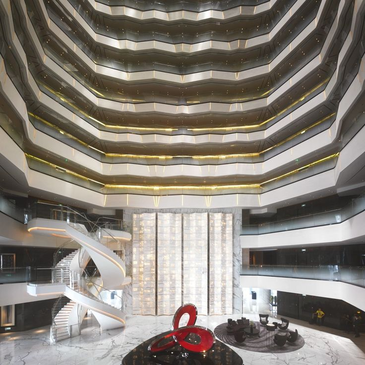 Four Seasons Hotel has opened a 33-floor luxury hotel at the top of the Guangzhou International Finance Center in China. From the ground floor, guests of Four Seasons Hotel Guangzhou take dedicated express elevators to the 70th floor lobby, where a dramatic 10 foot red steel sculpture by Australian artist Matthew Harding appears to float on a sea of watery glass.