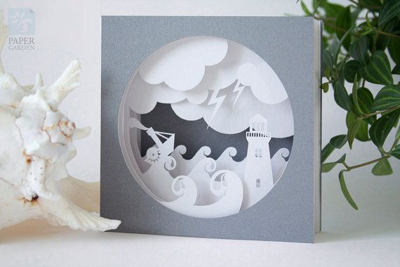 Printable PDF papercutting template of 3d pop-up card. Card design is the sea scene with ship and lighthouse. It consists four inner layers and