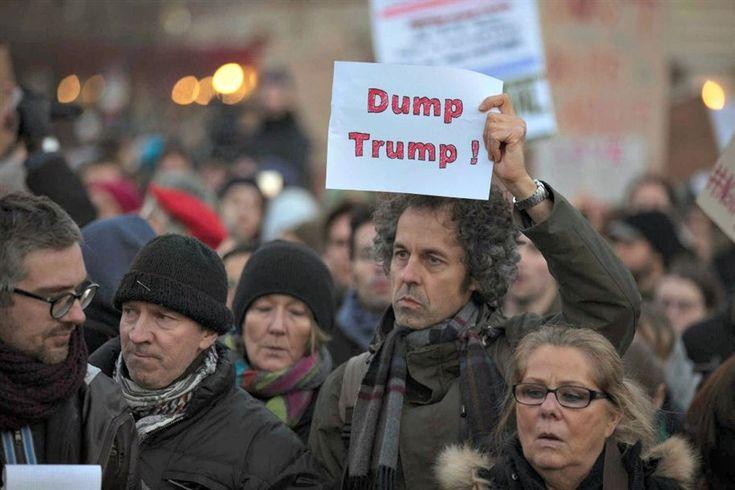 Cerca de meio milhar de pessoas concentraram-se este sábado junto à embaixada norte-americana em Berlim numa manifestação contra o presidente eleito nos Estados Unidos, Donald Trump, e o seu projeto de construir um muro na fronteira com o México.