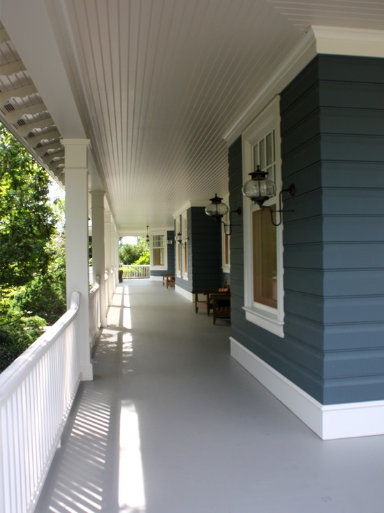 love everything about this wrap around porch... I would add ceiling fans though.