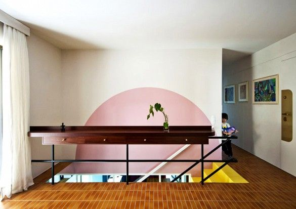 Semi-circle in pink on wall of upper stairway in modern home