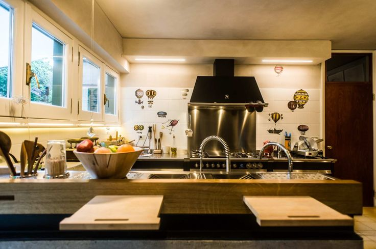large kitchen: oak steel and cement for private home