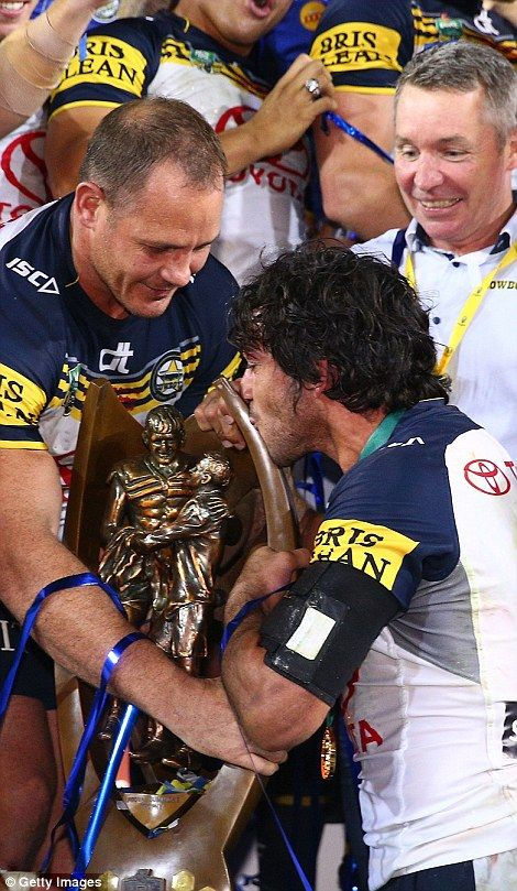 Thurston seals his team's win with a kiss on the premiership trophy