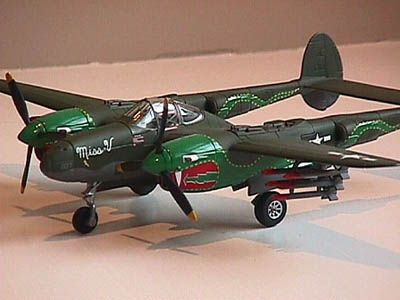 """80th Fighter Group (FG) """"Burma Banshee"""" P-38. You can see her unique """"Twin Dragon"""" art. The 459th Fighter Squadron was the only one of the Banshee squadrons to fly the P-38, and it came to be known as the """"Twin Dragons."""" This model is in honor of Capt. Walter Duke, a leading """"Ace"""" of the 10th AAF, a 459th FS """"Twin Dragon"""" lost in combat in June, 1944. His aircraft was """"Miss V"""