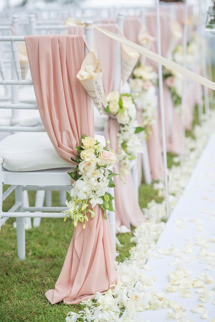 """Aisle decor with dusty rose drapes and white and yellow flowers // Wedding Boutique Phuket dreamt up a vintage European """"Key of Love""""-inspired celebration on the beachfront lawn of Renaissance Phuket Resort & Spa, Thailand, for David and Ivy. Captured by Darinimages, this wedding theme came complete with vintage key motifs, shades of Rose Quartz and Serenity Blue, and a vintage door ceremony backdrop opening out into the sea."""