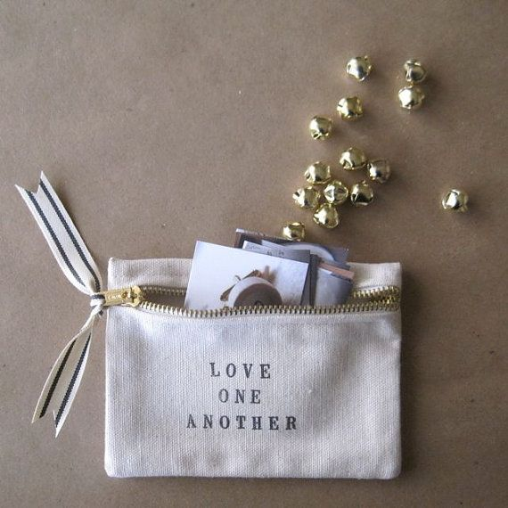 canvas zippered pouch LOVE ONE ANOTHER by Paloma's by palomasnest, $24.00; @Isabelle, they also do gorgeous ceramics and tags for weddings, babies, etc.
