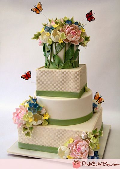 Very nice! Spring cake with mixed shaped tiers, basket weave, lots of flowers and butterflies/