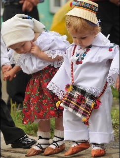 roumanie.. Two toddlers dressed in ethnic costumes look beyond adorable!