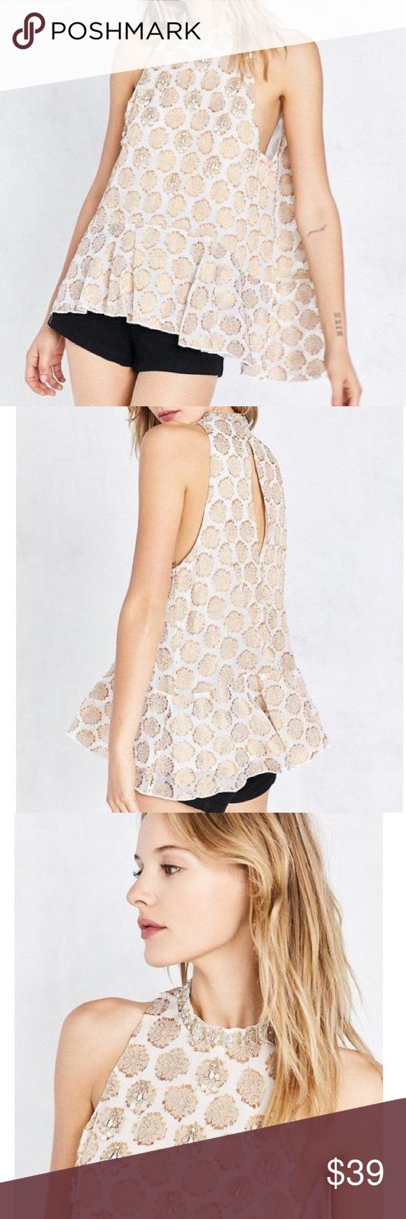 """Urban outfitters beaded gold swing tank S/M Brand new with tags. Gold high neck swing tank jacquard print by kimchi blue of urban outfitters. Light woven application sleeveless low armholes, loose fit and ruffle peplum hem. Finished with keyhole clasp closure at the back. Rayon/polyester/metallic. Chest 36"""" length 25"""" 🌷 will ship after 5/9. Urban Outfitters Tops Blouses"""