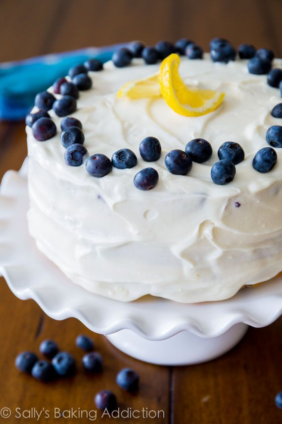 Deliciously sweet and light Lemon Blueberry Layer Cake. Tangy cream cheese frosting gives each bite a sweet touch!