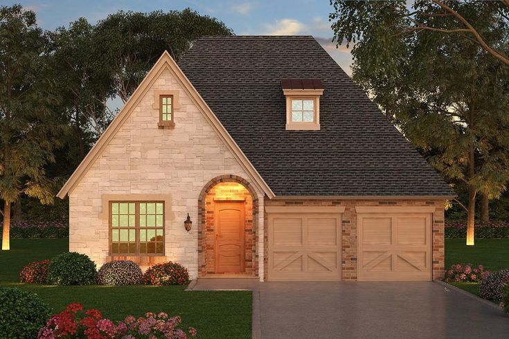 This cozy, 1-story European house plan has 2,640 sq. ft., 3 bedrooms, 2.5 bathrooms and an open floor plan. With vaulted ceilings, Plan 5445-00299 has more room than meets the eye.
