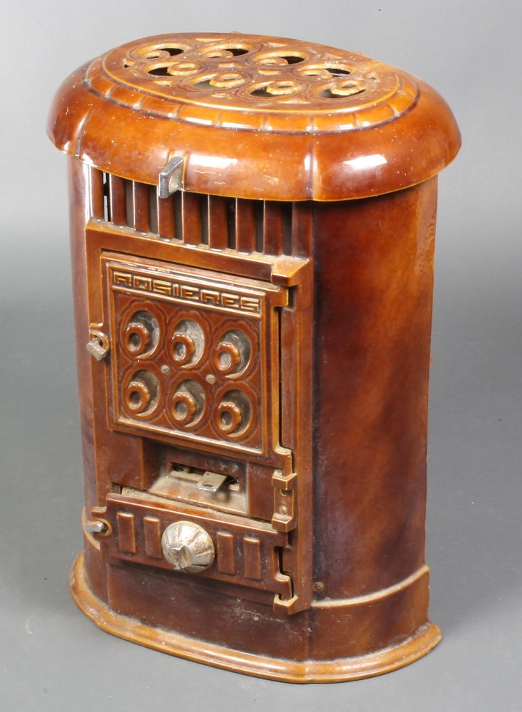 """Lot 155, A Rosieres French oval brown enamelled solid fuel stove 24""""h x 18""""w x 13""""d, sold for £150"""