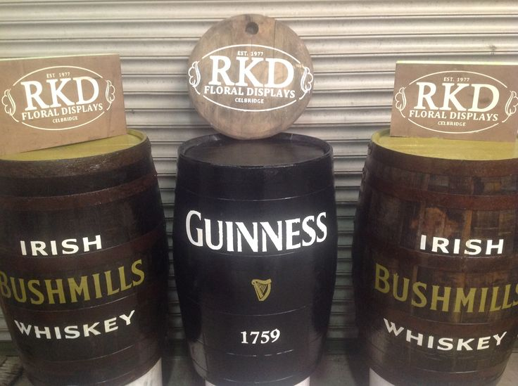 Guinness and Irish Whiskey barrels with loges done by RKD Floral Displays