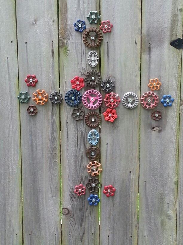 Cross...faucet handles. Garden Art Fence art