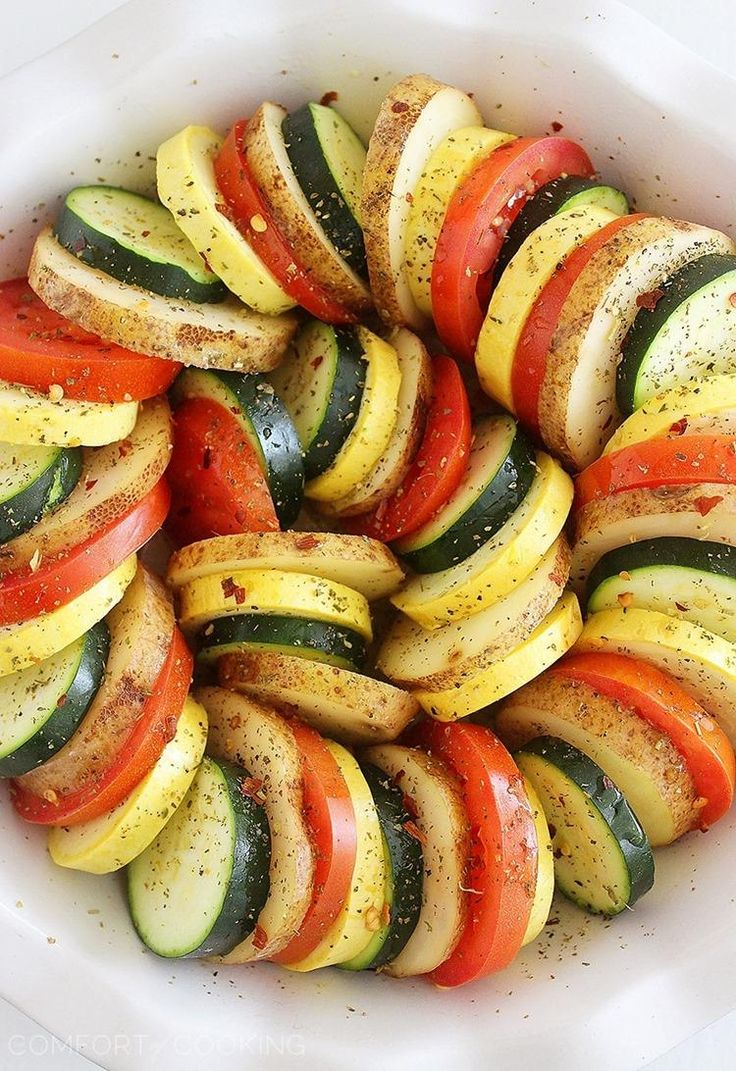 Parmesan Vegetable Tian – Our all-time favorite side dish! Layered potatoes, zucchini, tomatoes and squash, baked 'til tender & crisp with a cheesy Parmesan topping. Healthy, colorful and delicious on the side of roasted meats! | thecomfortofcooking.com